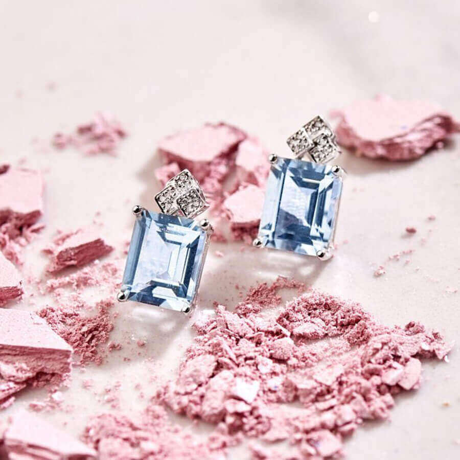 Personal, Earrings with a blue aquamarine stone