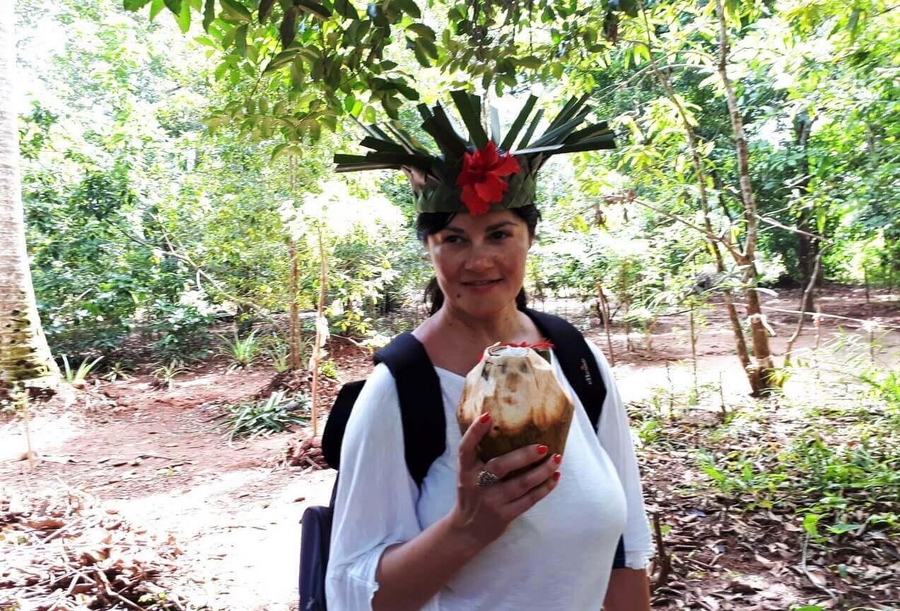 Tasting a fresh coconut, Jambo Farm Dole